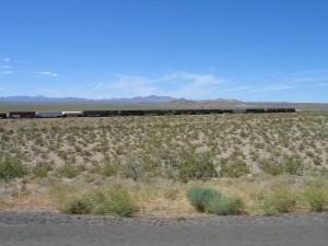Train Moving Through The Mojave Desert