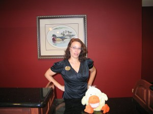 Jim's Duck poses with the clerk at the Homewood Suites in Medford, Oregon