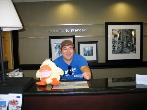 The guy at the Merced Hampton Inn teaches Jim's duck about breweries in Ukiah